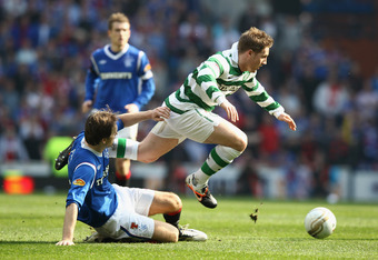 GLASGOW, SCOTLAND - MARCH 25:  Gary Hooper of Celtic is tackled by Sasa Papac of Rangers during the Clydesdale Bank Scottish Premier League match between Rangers and Celtic at Ibrox Stadium on March 25, 2012 in Glasgow, Scotland.  (Photo by Ian Walton/Get