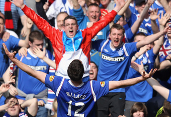 GLASGOW, SCOTLAND - MARCH 25:  Lee Wallace of Rangers celebrates after scoring his team's third goal during the Scottish Clydesdale Bank Scottish Premier League match between Rangers and Celtic at Ibrox Stadium on March 25, 2012 in Glasgow, Scotland.  (Ph
