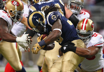 ST. LOUIS, MO - JANUARY 1: Steven Jackson #39 of the St. Louis Rams is tackled by Ahmad Brooks #55 and Ian Williams #93 both of the San Francisco 49ers at the Edward Jones Dome on January 1, 2012 in St. Louis, Missouri.  The 49ers beat the Rams 34-27.  (P