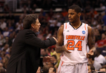 PHOENIX, AZ - MARCH 24:  Head coach Rick Pitino of the Louisville Cardinals talks with Chane Behanan #24 while taking on the Florida Gators during the 2012 NCAA Men's Basketball West Regional Final at US Airways Center on March 24, 2012 in Phoenix, Arizon