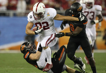 GLENDALE, AZ - JANUARY 02: Coby Fleener #82 of the Stanford Cardinal runs for yards after the catch against the Oklahoma State Cowboys during the Tostitos Fiesta Bowl on January 2, 2012 at University of Phoenix Stadium in Glendale, Arizona.  (Photo by Don