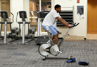 CHAPEL HILL, NC - JANUARY 29: Dexter Strickland #1 of the North Carolina Tar Heels rehabs in the training room after recently tearing his ACL ahead of their game against the Georgia Tech Yellow Jackets at the Dean Smith Center on January 29, 2012 in Chape