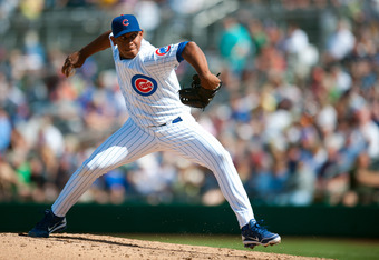 MESA, AZ - MARCH 8: Carlos Marmol #49 of the Chicago Cubs pitches during the game against the Seattle Mariners at HoHoKam Stadium on March 8, 2012 in Mesa, Arizona. (Photo by Rob Tringali/Getty Images)