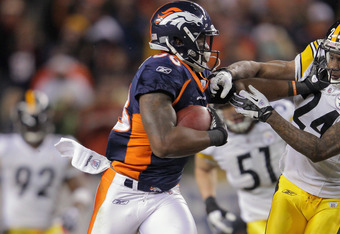 Wide receiver Demaryius Thomas stiff arms his opponent in the 2012 Wild Card game