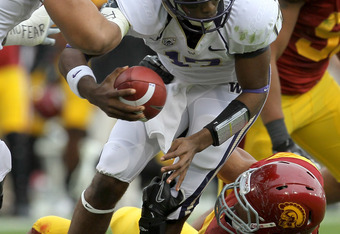 LOS ANGELES, CA - NOVEMBER 12:  Defensive end Nick Perry #8 of the USC Trojans sacks quarterback Keith Price #17 of the Washington Huskies at the Los Angeles Memorial Coliseum on November 12, 2011 in Los Angeles, California.  USC won 40-17.  (Photo by Ste
