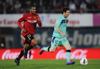 MALLORCA, SPAIN - MARCH 24:  Lionel Messi of FC Barcelona (R) is chased by Fernando Tissone of RCD Mallorca during the La Liga match between RCD Mallorca and FC Barcelona at Iberostar Stadium on March 24, 2012 in Mallorca, Spain.  (Photo by David Ramos/Ge