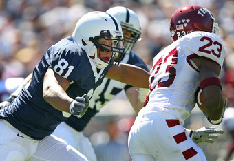 STATE COLLEGE, PA - SEPTEMBER 19: Defensive end Jack Crawford #81 of the Penn State Nittany Lions pursues wide receiver James Nixon #23 of the Temple Owls during a game on September 19, 2009 at Beaver Stadium in State College, Pennsylvania. (Photo by Hunt
