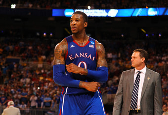 ST LOUIS, MO - MARCH 25:  Thomas Robinson #0 of the Kansas Jayhawks reacts late in the second half against the North Carolina Tar Heels during the 2012 NCAA Men's Basketball Midwest Regional Final at Edward Jones Dome on March 25, 2012 in St Louis, Missou