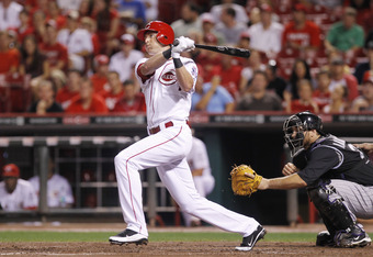 CINCINNATI, OH - AUGUST 8: Drew Stubbs #6 of the Cincinnati Reds hits a two-run home run in the third inning against the Colorado Rockies at Great American Ball Park on August 8, 2011 in Cincinnati, Ohio. (Photo by Joe Robbins/Getty Images)