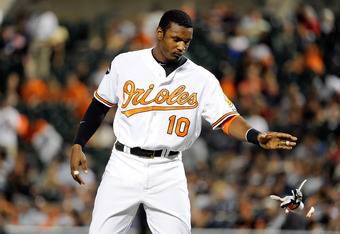 BALTIMORE, MD - AUGUST 29:  Adam Jones #10 of the Baltimore Orioles throws his batting gloves after striking out to end the eighth inning against the New York Yankees at Oriole Park at Camden Yards on August 29, 2011 in Baltimore, Maryland.  (Photo by Gre