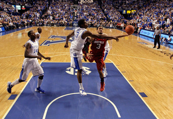 LEXINGTON, KY - DECEMBER 31:  Peyton Siva #3 of the Louisville Cardinals shoots the ball while defended by Terrence Jones #3 of the Kentucky Wildcats during 69-62 Wildcats victory at Rupp Arena on December 31, 2011 in Lexington, Kentucky.  (Photo by Andy