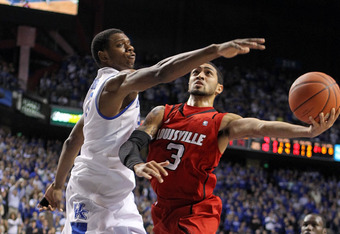 LEXINGTON, KY - DECEMBER 31: Peyton Siva #3 of the Louisville Cardinals shoots the ball while defended by Terrence Jones #3 of the Kentucky Wildcats during 69-62 Wildcats victory at Rupp Arena on December 31, 2011 in Lexington, Kentucky.  (Photo by Andy L