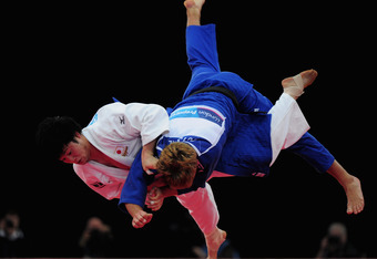 LONDON, ENGLAND - DECEMBER 04:  Norihide Yamamoto of Japan throws Yannick Gutsche of Germany during there 90kg Bronze Medal bout during the LOCOG Judo test event for London 2012 at ExCel on December 4, 2011 in London, England.  (Photo by Jamie McDonald/Ge