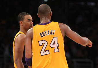 LOS ANGELES, CA - MARCH 16:  Ramon Sessions #7 and Kobe Bryant #24 of the Los Angeles Lakers consult on the court in the game against the Minnesota Timberwolves at Staples Center on March 16, 2012 in Los Angeles, California.  The Lakers won 97-92.  NOTE T