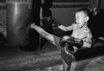 4 Dec 2000:  A young kickboxer workouts out at a camp in the  Klong Toei neighborhood of Bangkok,Thailand. Workouts in the Klong Toei start in early afternoon and go well into the night. Kids are taught the proper techniques of Muay Thai as early as four