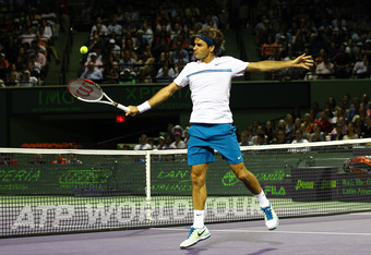 KEY BISCAYNE, FL - MARCH 26:  Roger Federer of Switzerland in action against Andy Roddick of the USA during Day 8  at Crandon Park Tennis Center at the Sony Ericsson Open on March 26, 2012 in Key Biscayne, Florida.  (Photo by Al Bello/Getty Images)