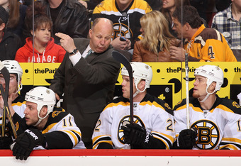 GLENDALE, AZ - DECEMBER 28:  Head coach Claude Julien of the Boston Bruins talks with Shawn Thornton #22 during the NHL game against the Phoenix Coyotes at Jobing.com Arena on December 28, 2011 in Glendale, Arizona. The Bruins defeated the Coyotes 2-1 in
