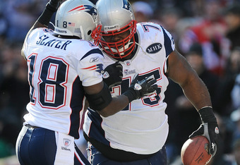 LANDOVER, MD - DECEMBER 11:   Vince Wilfork #75 of the New England Patriots celebrates with Matthew Slater #18 of the New England Patriots after scoring on a fumble by  Rex Grossman #8 of the Washington Redskins at FedExField on December 11, 2011 in Lando