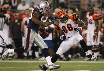 FOXBORO, MA - AUGUST 20:  Daniel Coats #86 of the Cincinnati Bengals fumbles the ball against Shawn Crable #98 of  the New England Patriots during their preseason game at Gillette Stadium on August 20, 2009 in Foxboro, Massachusetts.  (Photo by Jim Rogash