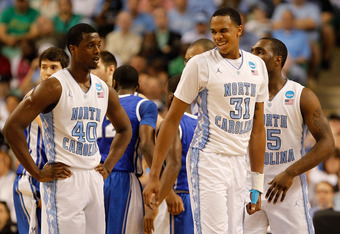 GREENSBORO, NC - MARCH 18:  (R) John Henson #31 of the North Carolina Tar Heels reacts as he stands with teammate Harrison Barnes #40  in the first half against the Creighton Bluejays during the third round of the 2012 NCAA Men's Basketball Tournament at