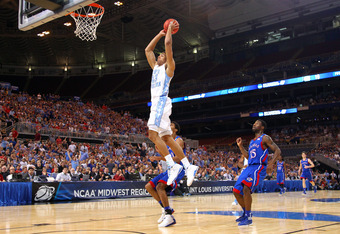 ST LOUIS, MO - MARCH 25:  James Michael McAdoo #43 of the North Carolina Tar Heels dunks in the first half against Kevin Young #40 and Elijah Johnson #15 of the Kansas Jayhawks during the 2012 NCAA Men's Basketball Midwest Regional Final at Edward Jones D