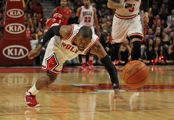 CHICAGO, IL - MARCH 24: C.J. Watson #7 of the Chicago Bulls chases down a loose ball against the Toronto Raptors at the United Center on March 24, 2012 in Chicago, Illinois. The Bulls defeated the Raptors 102-101 in overtime. NOTE TO USER: User expressly