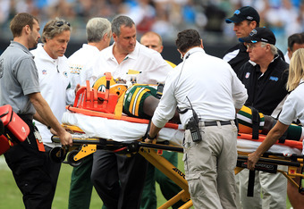 CHARLOTTE, NC - SEPTEMBER 18:  Play is stoped as Nick Collins #36 of the Green Bay Packers is injured against the Carolina Panthers during their game at Bank of America Stadium on September 18, 2011 in Charlotte, North Carolina.  (Photo by Streeter Lecka/