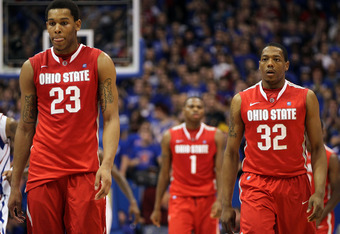 LAWRENCE, KS - DECEMBER 10:  Amir Williams #23 and Lenzelle Smith, Jr. of the Ohio State Buckeyes walk back upcourt after a timeout during the game against the Kansas Jayhawks on December 10, 2011 at Allen Fieldhouse in Lawrence, Kansas.  (Photo by Jamie