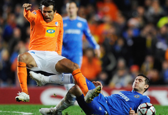 LONDON, ENGLAND - DECEMBER 08:  Frank Lampard of Chelsea tackles Nuno Morais of APOEL Nicosia during the UEFA Champions League Group D match between Chelsea and Apoel Nicosia at Stamford Bridge on December 8, 2009 in London, England.  (Photo by Jamie McDo