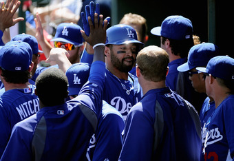 TEMPE, AZ - MARCH 12:  Matt Kemp #27 of the Los Angeles Dodgers celebrates while playing the Los Angeles Angels of Anaheim in the spring training baseball game at Tempe Diablo Stadium on March 12, 2012 in Tempe, Arizona.  (Photo by Kevork Djansezian/Getty