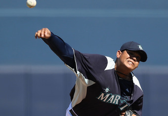 PEORIA, AZ - MARCH 06:  Starting pitcher Felix Hernandez #34 of the Seattle Mariners pitches against the Cincinnati Reds during the spring training game at Peoria Stadium on March 6, 2012 in Peoria, Arizona.  (Photo by Christian Petersen/Getty Images)