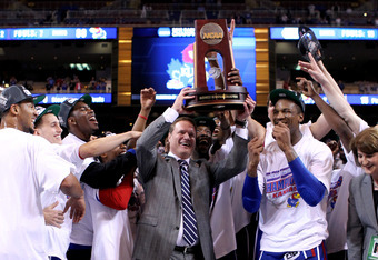 ST LOUIS, MO - MARCH 25:  Head coach Bill Self (C)of the Kansas Jayhawks celebrates with the Midwest regional championship trophy with players Tyshawn Taylor #10 (R of self) and Thomas Robinson #0 (2nd R of Self) after Kansas won 80-67 against the North C