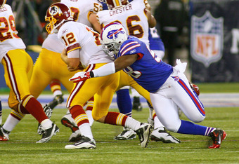 TORONTO, ON - OCTOBER 30: Kirk Morrison #58 of the Buffalo Bills sacks John Beck #12 of the Washington Redskins at Rogers Centre on October 30, 2011 in Toronto, Ontario. Buffalo won 23-0.  (Photo by Rick Stewart/Getty Images)