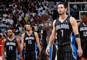 ATLANTA, GA - APRIL 28:  J.J. Redick #7 of the Orlando Magic walks to the bench fter missing a game-tying three-point basket in the final seconds against the Atlanta Hawks during Game Six of the Eastern Conference Quarterfinals in the 2011 NBA Playoffs at