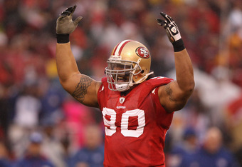 SAN FRANCISCO, CA - JANUARY 22:  Isaac Sopoaga #90 of the San Francisco 49ers reacts against the New York Giants during the NFC Championship Game at Candlestick Park on January 22, 2012 in San Francisco, California.  (Photo by Ezra Shaw/Getty Images)