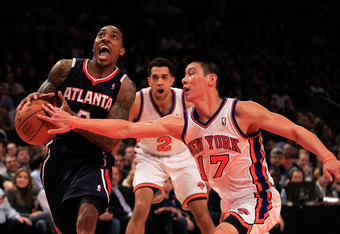 NEW YORK, NY - FEBRUARY 22: Jeff Teague #0 of the Atlanta Hawks drives against Jeremy Lin #17 of the New York Knicks at Madison Square Garden on February 22, 2012 in New York City. NOTE TO USER: User expressly acknowledges and agrees that, by downloading
