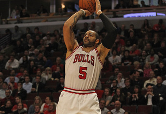 CHICAGO, IL - MARCH 26:  Carlos Boozer #5 of the Chicago Bulls looks puts up a shot against the Denver Nuggets at the United Center on March 26, 2012 in Chicago, Illinois. The Nuggets defeated the Bulls 108-91. NOTE TO USER: User expressly acknowledges an