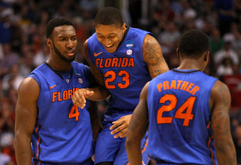 PHOENIX, AZ - MARCH 24:  Patric Young #4, Bradley Beal #23 and Casey Prather #24 of the Florida Gators celebrate with teammates in the second half while taking on the Louisville Cardinals during the 2012 NCAA Men's Basketball West Regional Final at US Air