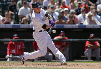 DENVER, CO - AUGUST 07:  Troy Tulowitzki #2 of the Colorado Rockies makes contact as he takes an at bat against the Washington Nationals at Coors Field on August 7, 2011 in Denver, Colorado.  (Photo by Doug Pensinger/Getty Images)
