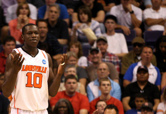 PHOENIX, AZ - MARCH 24:  Gorgui Dieng #10 of the Louisville Cardinals reacts in the second half while taking on the Florida Gators during the 2012 NCAA Men's Basketball West Regional Final at US Airways Center on March 24, 2012 in Phoenix, Arizona.  (Phot