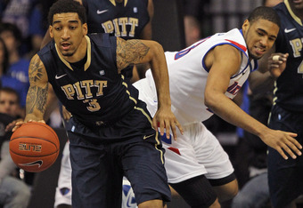ROSEMONT, IL - JANUARY 05: Cameron Wright #3 of the Pittsburgh Panthers breaks away from Donnavan Kirk #23 of the DePaul Blue Demons at Allstate Arena on January 5, 2012 in Rosemont, Illinois. DePaul defeated Pittsburg 84-81. (Photo by Jonathan Daniel/Get
