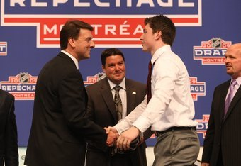 MONTREAL - JUNE 26:  Matt Duchene (r) shakes hands with Colorado Avalanche General Manager Greg Sherman after being drafted during the first round of the 2009 NHL Entry Draft at the Bell Centre on June 26, 2009 in Montreal, Quebec, Canada. (Photo by Bruce