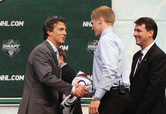 ST PAUL, MN - JUNE 24:  Second overall pick Gabriel Landeskog by the Colorado Avalanche shakes hands with Joe Sakic of the Colorado Avalanche during day one of the 2011 NHL Entry Draft at Xcel Energy Center on June 24, 2011 in St Paul, Minnesota.  (Photo