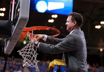 ST LOUIS, MO - MARCH 25:  Head coach Bill Self of the Kansas Jayhawks cuts down a piece of the net in celebration of winning 80-67 against the North Carolina Tar Heels during the 2012 NCAA Men's Basketball Midwest Regional Final at Edward Jones Dome on Ma