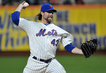 NEW YORK, NY - SEPTEMBER 12: R.A. Dickey #43 of the New York Mets throws a pitch during the game against the Washington Nationals at Citi Field on September 12, 2011 in the Flushing neighborhood of the Queens borough of New York City. (Photo by Christophe
