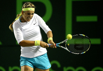 KEY BISCAYNE, FL - MARCH 25:  Victoria Azarenka of Belarus returns a shot to Heather Watson of Great Britain during the Sony Ericsson Open at the Crandon Park Tennis Center on March 25, 2012 in Key Biscayne, Florida.  (Photo by Matthew Stockman/Getty Imag