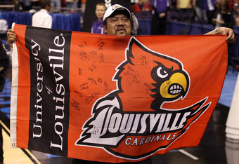 PHOENIX, AZ - MARCH 24:  Peyton Siva Sr. the father of Peyton Siva #3 of the Louisville Cardinals celebrates after the Cardinals defeated the Florida Gators 72-68 during the 2012 NCAA Men's Basketball West Regional Final at US Airways Center on March 24,
