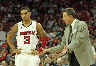 LOUISVILLE, KY - NOVEMBER 11:  Rick Pitino the Head Coach of the Louisville Cardinals gives instructions to Peyton Siva #3 during the exhibition game against the Kentucky Wesleyan Panthers  at the KFC Yum! Center on November 11, 2010 in Louisville, Kentuc
