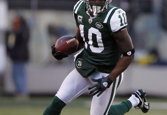 EAST RUTHERFORD, NJ - DECEMBER 24:  Santonio Holmes #10 of the New York Jets runs after a catch during a game against the New York Giants at MetLife Stadium on December 24, 2011 in East Rutherford. New Jersey. The Giants won 29 - 14. (Photo by Rich Schult