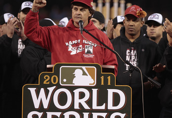 ST. LOUIS, MO - OCTOBER 30: Manager Tony La Russa (L-R) speaks to fans as Octavio Dotel and Albert Pujols of the St. Louis Cardinals look on during a ceremony celebrating the team's 11th World Series championship October 30, 2011 at Busch Stadium in St. L